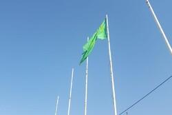 اهتزاز پرچم امام رضا(ع) بر بام خرمآباد