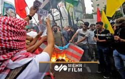 VIDEO: Protestors burn US flag outside US embassy in Beirut