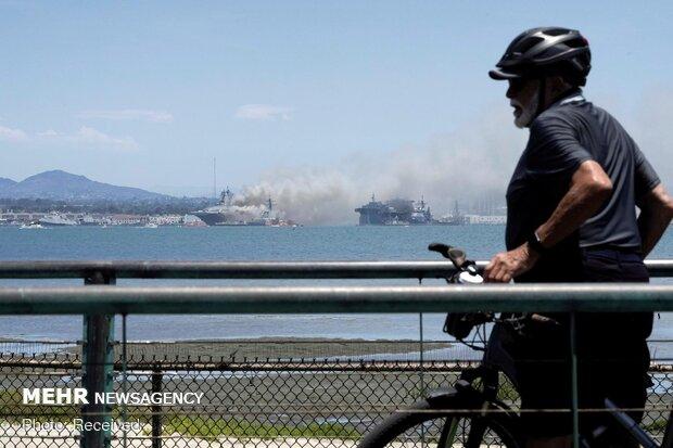 انفجار و آتش سوزی در یک فروند ناو جنگی آمریکا