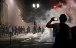 US federal agents fire tear gas on peaceful protesters