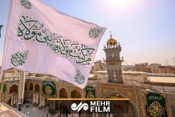 مراسم تعویض پرچم حرم حضرت علی(ع)