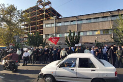 People in Tehran protest in front of French embassy