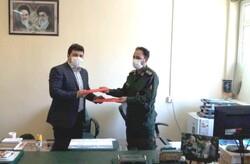 امضای تفاهم نامه همکاری هیات کشتی و تربیت بدنی سپاه اردبیل