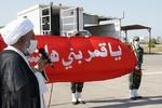 مراسم رونمایی از پرچم مرقد مطهر حضرت عباس (ع) در خارگ برگزار شد