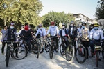 Ambassadors to Tehran ride bicycles with city Mayor
