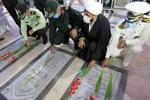 گلزار شهدای بوشهر غبارروبی و عطرافشانی شد
