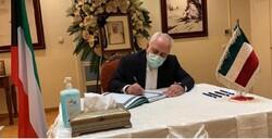 Zarif signs memorial notebook of late Emir of Kuwait