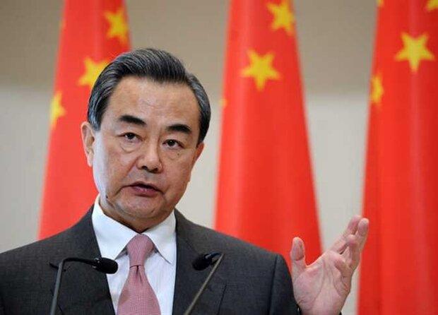 وزير الخارجية الصيني يؤكد على ضرورة  تعزيز التعاون مع إيران