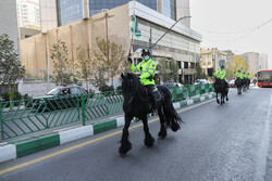 """Mounted Police Horse"" parades on Tehran's Vali-e Asr Ave."