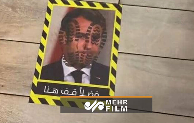 VIDEO: People walk on Macron's photo in Kuwaiti hotel