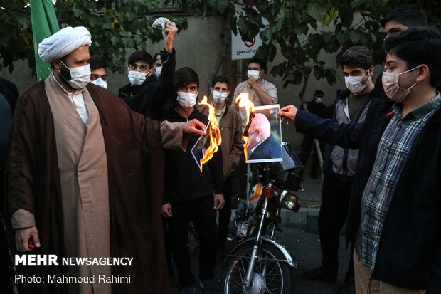 People hold protest in front of French Embassy in Tehran