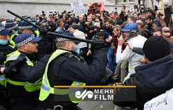 VIDEO:People gather in Manchester to protest against lockdown