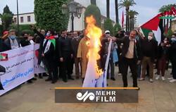 مغربیها پرچم رژیم صهیونیستی را به آتش کشیدند