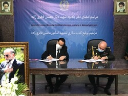 Signing of martyr Fakhrizadeh's memorial notebook by envoys