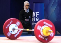 Iranian girls at intl. weightlifting c'ships for 1st time