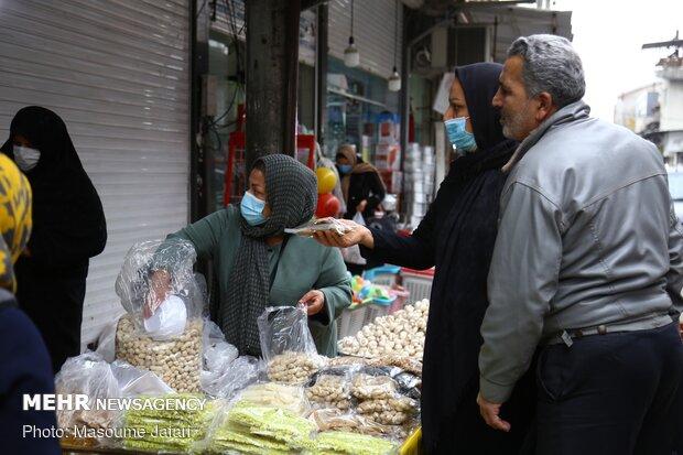 People preparing for Yalda Night in Sari