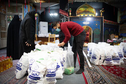 Distributing food assistance packages on eve of Yalda Night