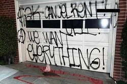 Protesters vandalize Pelosi's garage door