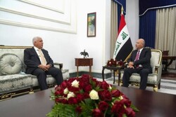 Iraqi president, sanctioned PMU head discuss security issues