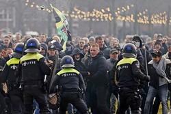 اعتراض به محدودیت های کرونایی در هلند/ پلیس به زور متوسل شد
