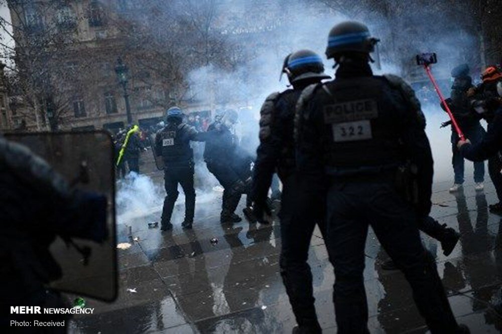 French police attack protesters in Paris on new security law