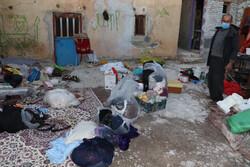 تلاش تیم های امدادی برای تخلیه منازل آسیب دیده شهر سی سخت