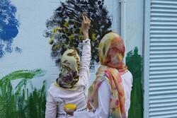 کودکان اوتیسم دیوارهای خیابان ولیعصر را نقاشی کردند