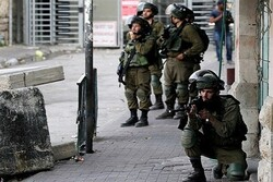 Zionists raid West Bank, arrest dozens of Palestinians
