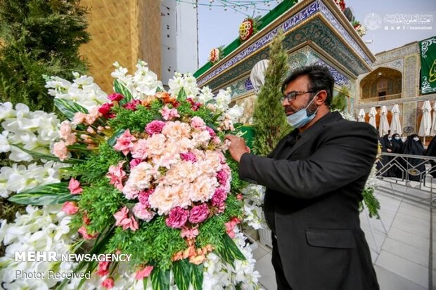 Imam Ali's holy shrine ornamented with flowers