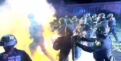 فروشگاه های پورتلند آمریکا به آتش کشیده شد/ تهدید پلیس به کاربرد زور