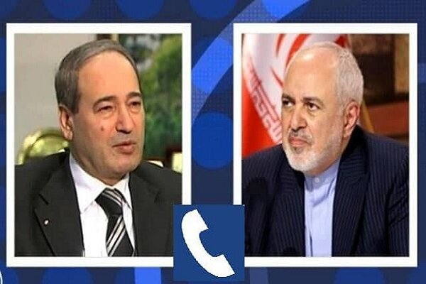 Iranian, Syrian FMs discuss ties, region in phone call