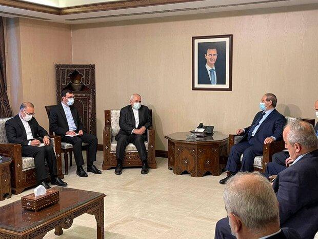 Zarif, Syrian counterpart discuss ties, region in Damascus