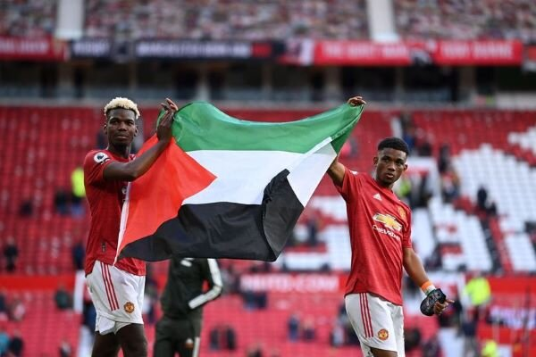 Palestine flag displayed by Man. Utd's Paul Pogba, Amad