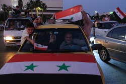 Syrian people celebrating victory of Bashar Asad in election