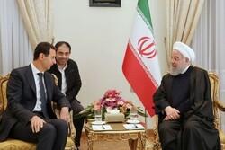 Ruhani'den yeniden devlet başkanı seçilen Esad'a tebrik mesajı