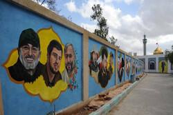 نقاشی چهره شهدای مقاومت بر دیواره حریم حرم حضرت زینب(س) نقش بست