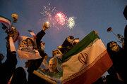 People celebrate Raeisi's victory in Tehran