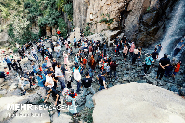 Ganjnameh Waterfall, best hub for travelers in hot summer