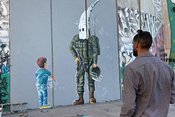 Filistinli ressamdan Ayrım Duvarı'na 'İsrail ırkçılığı' temalı çizim