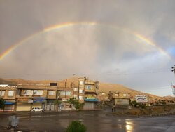 Summer rainfall and rainbow in Baneh