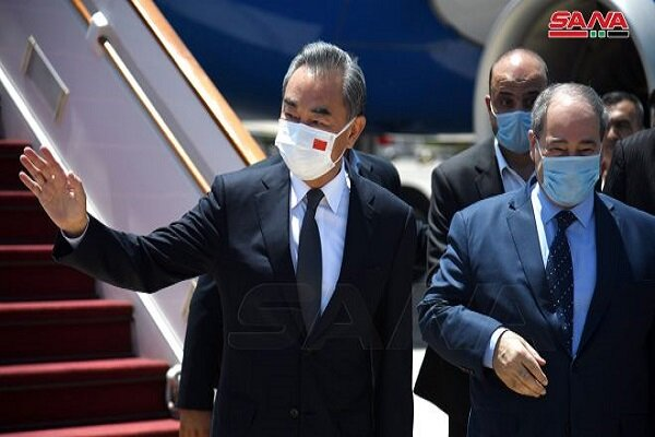 China foreign minister arrives in Damascus to sign deals