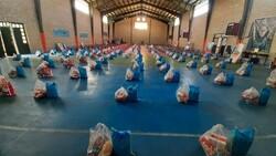 توزیع بیش از ۱۴۰۰ بسته غذایی در قالب کمک مومنانه در رزن و درگزین