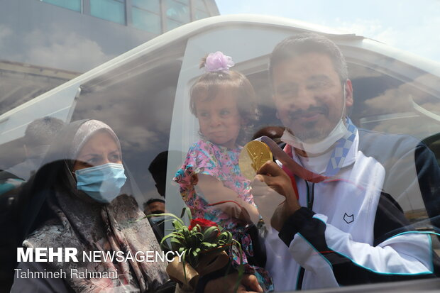 Welcoming gold medallist Javad Foroughi home