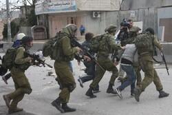 Zionist forces raid West Bank, arrest dozens of Palestinians
