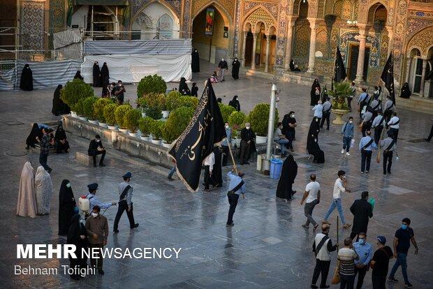 Imam Hussein flag raised up above Shah Abdol-Azim Shrine