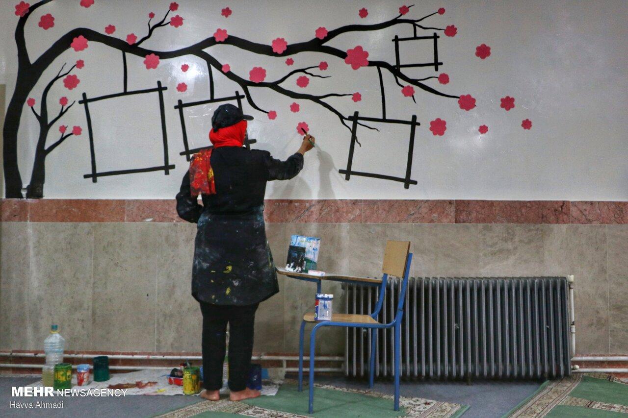Local artists paint school walls before schools re-open