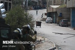 Zionists launch large-scale raid on Palestinians in Al-Quds