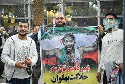 Iranian Greco-Roman wrestling team arrive home