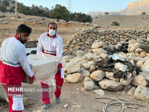 Distributing aid among Andika quake survivors