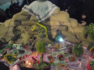 مردم شوش مراسم تحویل سال نو را در یادمان شهدای فتح المبین برگزار می کنند